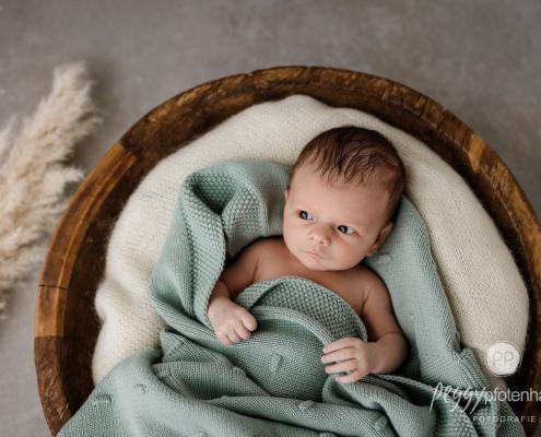 Newbornfotos zu Hause