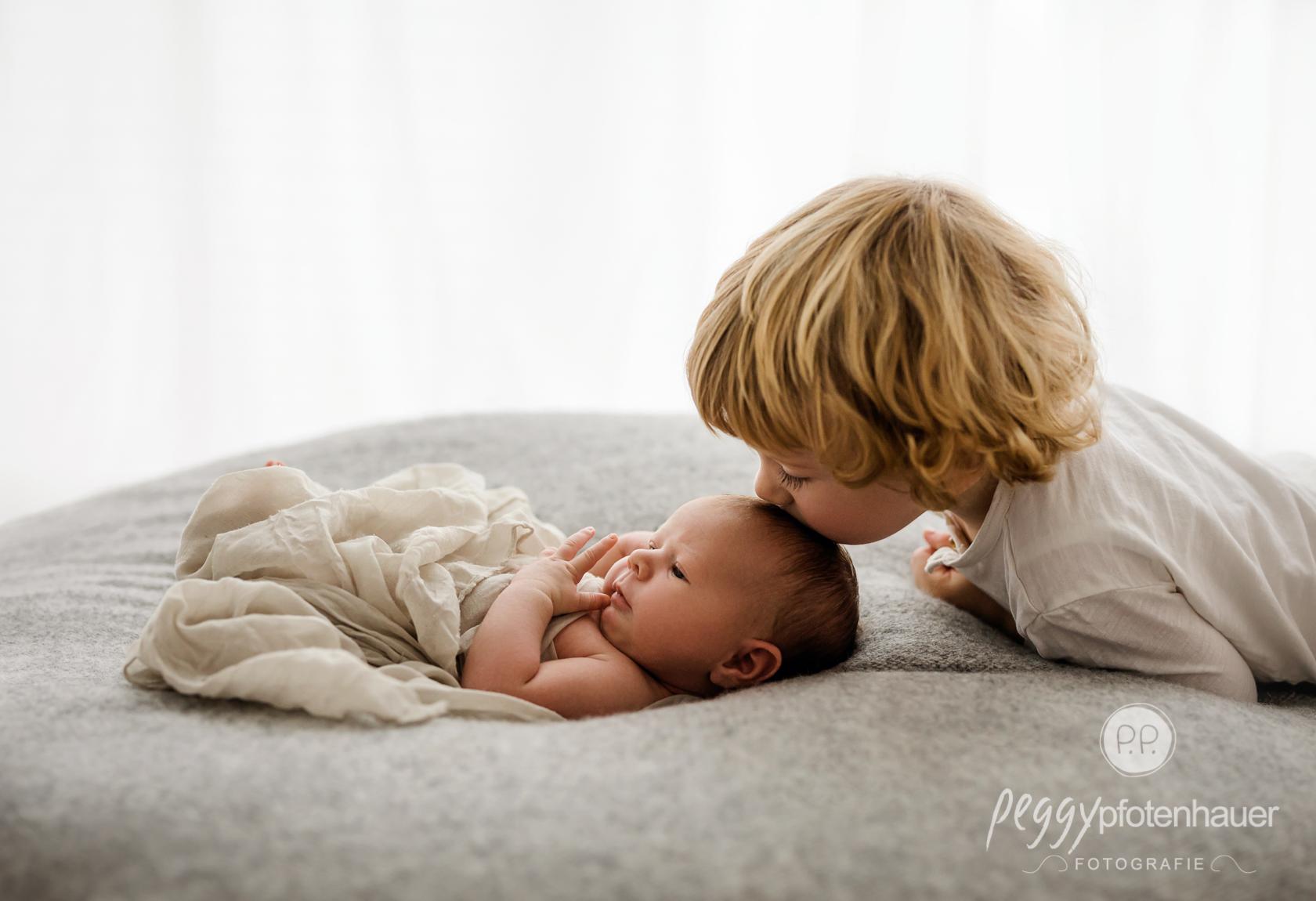 Geschwisterbilder mit Baby